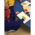 Callum using fruit to print in a creative session