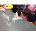 Emily mark making in sugar