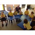 Everyone enjoying nursery rhymes around the table