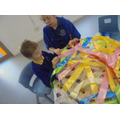 Developing fine motor skills: weaving a tent.