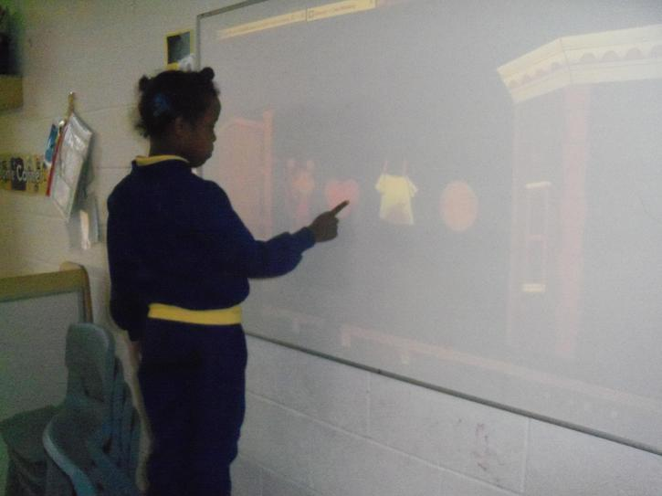 Hafsa using the interactive whiteboard