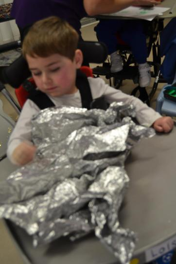 Jack liked the noise and feel of the space blanket