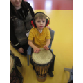 Connor exploring the drum with his hands