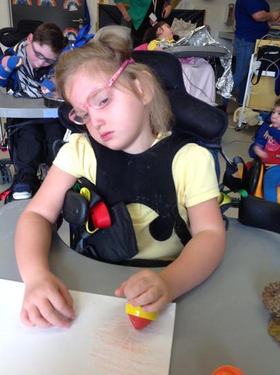 Louise using crayons to make rubbings
