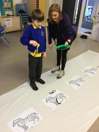 We had lots of fun adding stripes to the zebras!