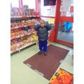 Sange choosing food in the Chinese supermarket