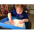 Laura Jane using both hands to mark make in snow.
