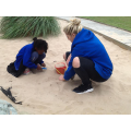 Hafsa and Rachel playing in the sand