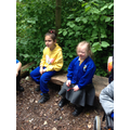 Grace and Jury enjoying being at forest school