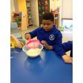 Achille sieving the flour