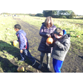 Getting the children to explore the pumpkins.