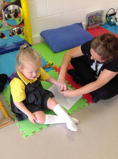 Liliana making rubbings with natural materials.