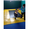 Liliana practicing her walking on an uneven surface in rebound