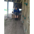 Connor likes playing under the climbin wall