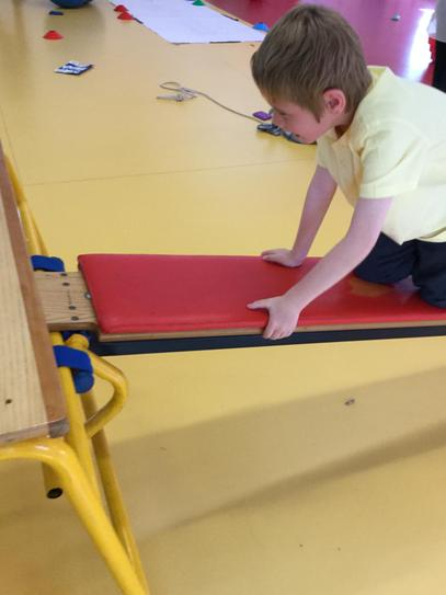 Oscar practicing how to crawl up the bench.