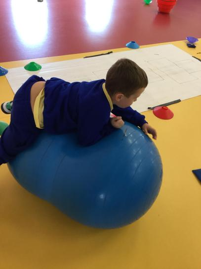 Ellis doing a calming exercise on the peanut ball.