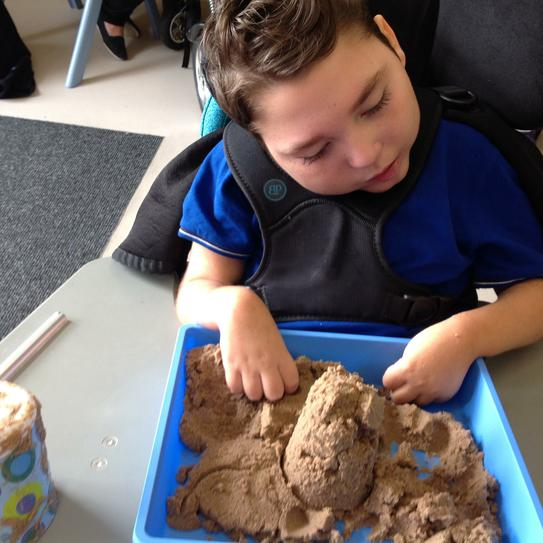 Building sandcastles to count.