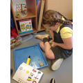 She enjoyed completing play tasks.
