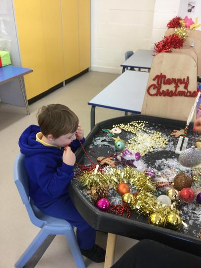Jake exploring our Christmas sensory tray.