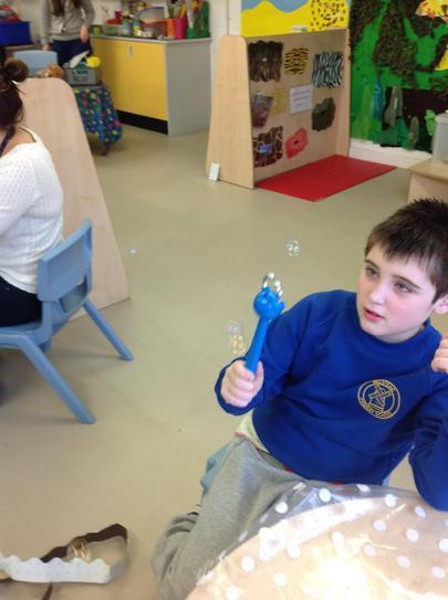 Elliott using gross motor movements to play