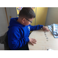 Mustafa can recognise coins and values.