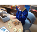 Ellis showing how many coins he has found.