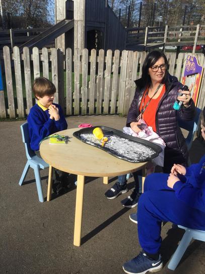 Using sensory play to encourage communication.