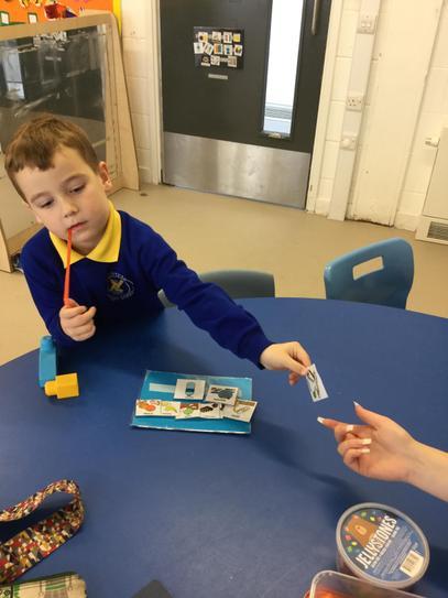 Ellis using PECs for snack.