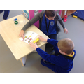 Following visual instructions in the play kitchen.