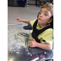 Matthew making marks in flour.