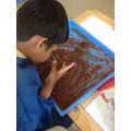 Ahmed enjoyed exploring the edible mud.