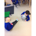 Poppy and Brandon playing together with a balloon.