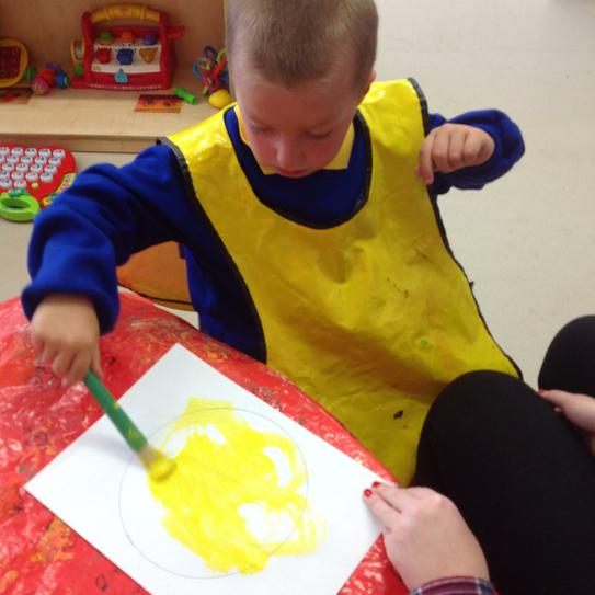 Alexis painting his dinner mat