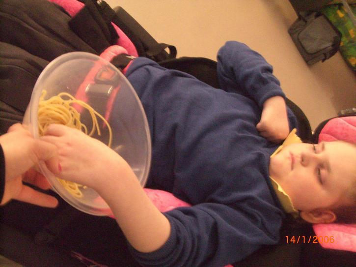 Freya independently exploring some pasta
