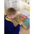 Luke developing his reading skills.