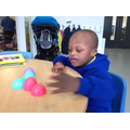 Sange copying patterns using coloured Easter eggs