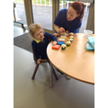 Millie counting using the talking tins