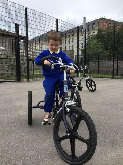 Ellis is learning how to steer the bike.