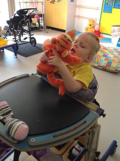 Liliana cuddling the teddy fur!