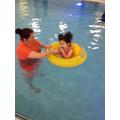 Charlotte practicing her swim skills