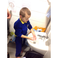 Washing our hands before cooking.