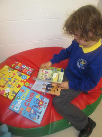 Connor checking out the noisy books