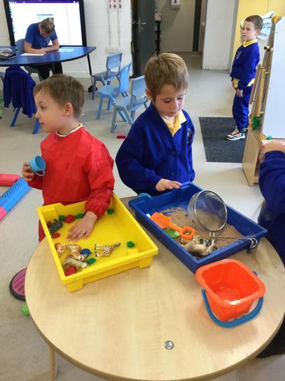 Exploring sensory trays together.