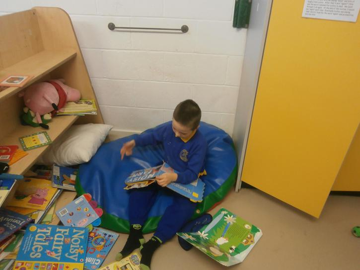 Declan exploring the books in reading area