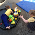 Poppy and Grace enjoying water play outside