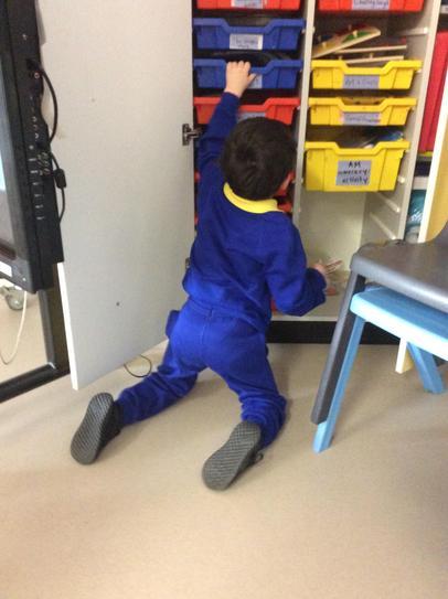 27/1 Brandon high kneeling to reach his toys