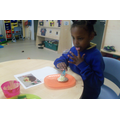 Hafsa choose to decorate a biscuit