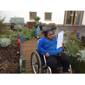 Eva having a walk through our sensory garden