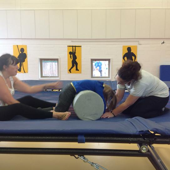 Louise working on kneeling over a roll