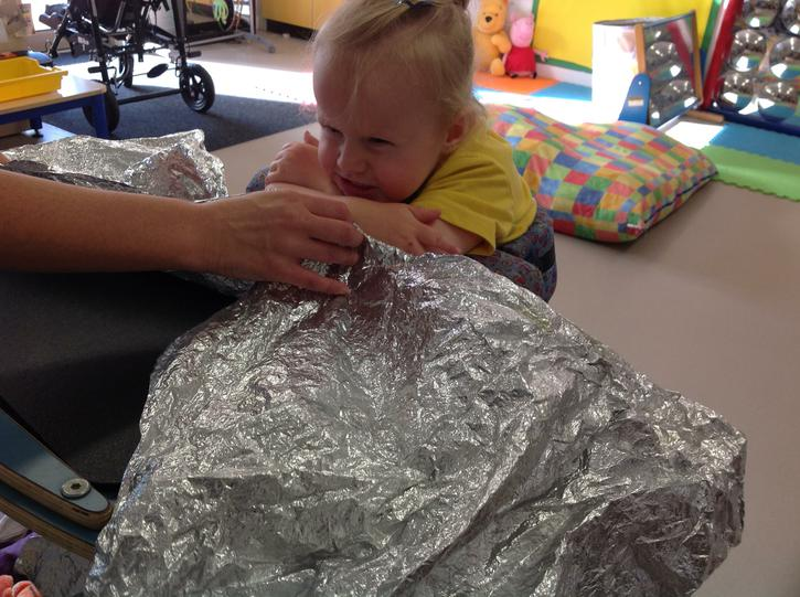 Liliana is a bit unsure about the space blanket!